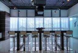 Blue Condo Miami table media room
